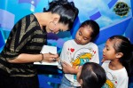 Nana Zakaria signing autographs for her young fans...