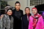 Taufik Batisah poses for the camera with Rahimah Rahim and an unidentified couple...