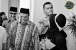 The wedding host, Shahid Saffar Ali, joking with the groom's entourage...