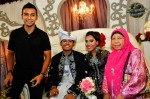 The wedding couple with Taufik and his mum, Madam Normainah Bachok...