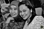 Madam Suharti Ali is all smiles with fellow Warna 94.2FM colleague, Zaza Majid...
