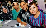 Mediacorp Suria staff Mufreha Ma'arof (right) and husband Ishak Jamid, with fellow colleague Farlina and hubby...