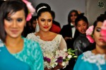 The bride entering the venue accompanied by her sisters...