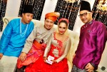 With the groom's siblings, Kamarudin (left) and Kadir...