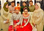 The couple, with Raffiey Nasir and family...