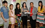 With artistes signed to MIG - Khor Junyang (left), Emily Chan (second from left) and Atikah Suhaime (right). Major Teo's wife, Mrs. Jane Teo, is the one in black...