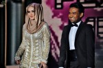 Dato' Siti Nurhaliza appearing with renowned fashion designer Rizman Ruzaini...