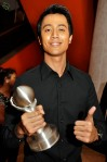 "A proud Aliff Aziz posing with the award he won for Best Singapore Song (""Jangan Ganggu Pacarku"")..."