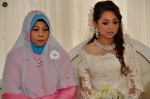 The bride getting emotional on the dais...