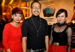Director and producer Adi Yadoni flanked by local singer Kaly Aziz and wife Wahyu Rahman...