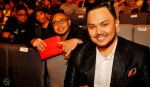 Imran Ajmain all smiles with The Trisno Trio at the back...