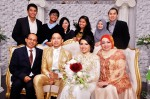 With the bride's family...