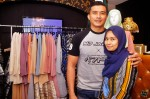 Aaron and Diyana posing in front of their stall...